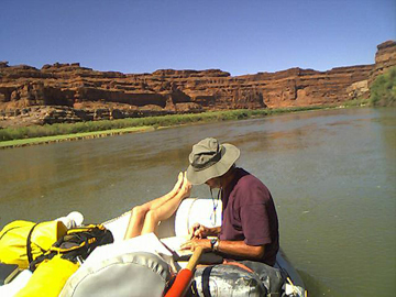 relaxing on the flatwater of cataract canyon